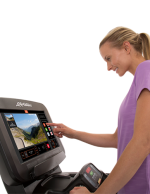 Discover-SE3-Console-female-exerciser-smiling-exploring-enterntainment-apps-79A7353500